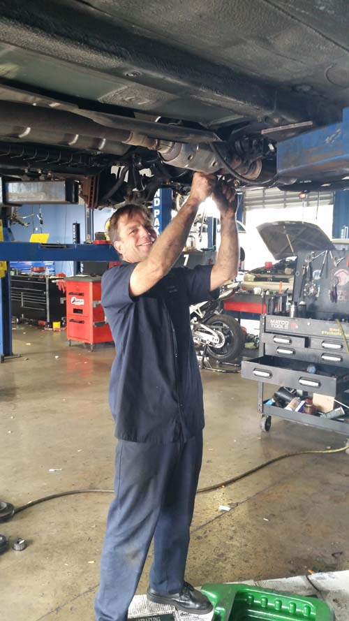 One of our ASE Certified Technicians at work in our garage.